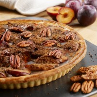 Plum, cinnamon and sour cream tart